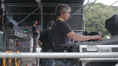 Technical worker controlling stage set  on the stage of rock concert Stock Footage