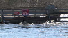 Spring flooding and rushing water after long cold snowy winter Stock Footage