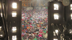 People watching a concert under the rain in front of the stage: Rome, 1 may Stock Footage