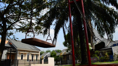 Empty swings swaying - stock footage