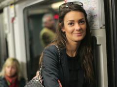 Happy beautiful woman riding metro train NTSC Stock Footage