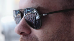 close up of young man watching rock concert: reflecting audience on sunglasses - stock footage