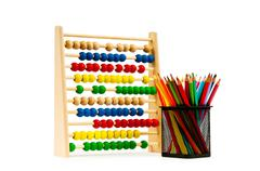 Abacus and pencils isolated on white Stock Photos
