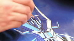 Hand made draw on motorcycle: artist making reproduction of japans cartoon Stock Footage