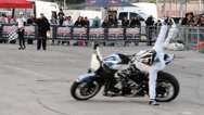 Stock Video Footage of professional stunt man makes circles with a motorcycle: exhibition, show