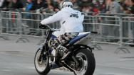 Stock Video Footage of stunt man zooming and drifting standing on the motorcycle