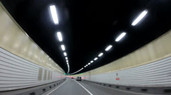 POV city driving illuminated Shanghai road tunnel Pudong China Stock Footage