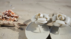 Rope starfish seashell flip flops on beach. HD with motorized slider. 1080p. Stock Footage