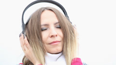 Young woman with headphones listening to chillout music Stock Footage