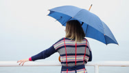 Stock Video Footage of Back of woman with umbrella on the sea pier. HD with motorized slider. 1080p.