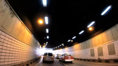 POV driving illuminated Shanghai road tunnel Pudong China Asia Stock Footage