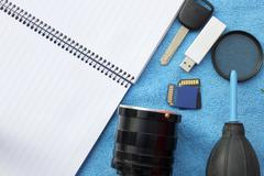 Accessories for travel. key car and lens memory card for camera have a notebook Stock Photos