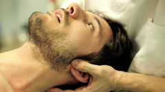 physiotherapist is doing massage to the face: the neck, muscles, nerves, tendons - stock footage