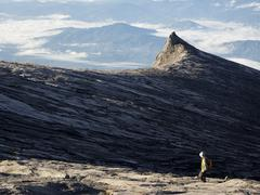 Hiker Walking at the Top of Mount Kinabalu in Sabah, Malaysia Stock Photos