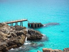 Sunken Pier in the Turquoise Colored Water of Pulau Perhentian, Malaysia Stock Photos