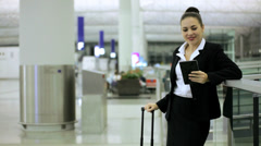 Stock Video Footage of Caucasian Businesswoman Airport Global Travel Tablet Communication