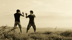 training martial arts in mountain place: fight, sport, athletes, fighting - stock footage