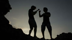 Silhouettes of two fighters training martial art, fight Stock Footage