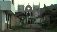 Dirt track leads to colonial style church Stock Footage