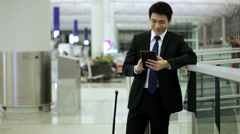 Male Asian Ethnic Business Traveller Airport Wireless Mini Tablet Stock Footage