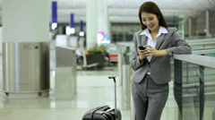 Asian Chinese Businesswoman Airport Travel Destination Smart Phone Stock Footage