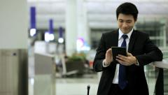 Wireless Mini Tablet Device Asian Chinese Male Airport Global Travel Stock Footage