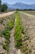 Dry irrigation ditch Stock Photos