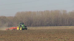 Tractor plough field ground farming machine worker industry cultivating land day Stock Footage