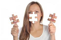 Young woman with two puzzles Stock Illustration