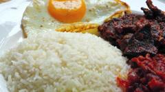 Nasi lemak (coconut rice) Stock Footage