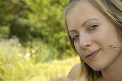 nice girl on the grass-plot with herb - stock photo