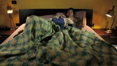 couple flirting in bed: joke, play, have fun, sexuality, love, living together - stock footage
