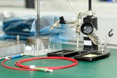 Electronics equipment assembly workplace Stock Photos