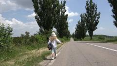 4K Child Little Girl Walking Road, Traffic, Runaway, Wandering Kid, Countrywoman - stock footage