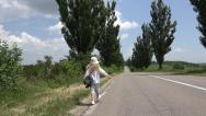 Stock Video Footage of Ultra HD 4K Girl Walking Road, Traffic, Runaway, Afield Lost Child, Countrywoman