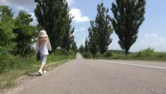 Stock Video Footage of 4K Child Little Girl Walking Road, Traffic, Runaway, Wandering Kid, Countrywoman