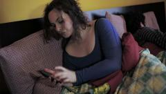 Woman using smartphone in the bed: couple problems, betrayal, treason Stock Footage