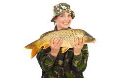 Happy fisherwoman with big fish - stock photo