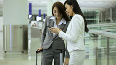 Asian Chinese Businesswomen Airport Global Travel Smart Phone Communication - stock footage
