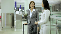 Stock Video Footage of Asian Chinese Businesswomen Airport Global Travel Smart Phone Communication