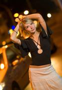 Beautiful young woman in a city at night Stock Photos
