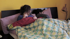 Couple problem: woman using mobile phone in the bed with her partner: betrayal Stock Footage
