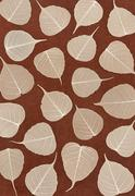 Skeletal leaves over brown handmade paper - background - stock photo