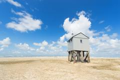 Drowning house at the beach Stock Photos