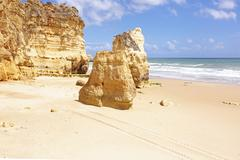 natural rocks at praia da rocha in portugal - stock photo