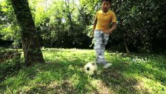 little boy running with the ball playing football: soccer, outdoor, children, - stock footage