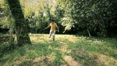 Little boy running with the ball playing football: soccer, outdoor, children, Stock Footage