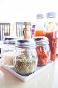 set of seasoning and sauce bottles - stock photo