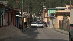 Painted houses on back street Stock Footage