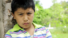 sad alone child stands near a tree: Boy, teen, looks, pensive, thoughts - stock footage